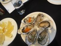 oysters from buffet table - papaya seed powder and papaya seed dressing, smoked miso with yuzu jelly, namjin dressing, rice vinegar and coriander marination, tabsaco caviar, nikka and lychee caviar