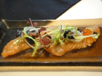 Cured Salmon Carpaccio with pickled leek, avruga, salmon roe, black garlic vinaigrette